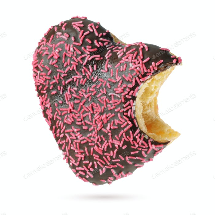 Bitten heart shape chocolate donut with red sprinkles isolated
