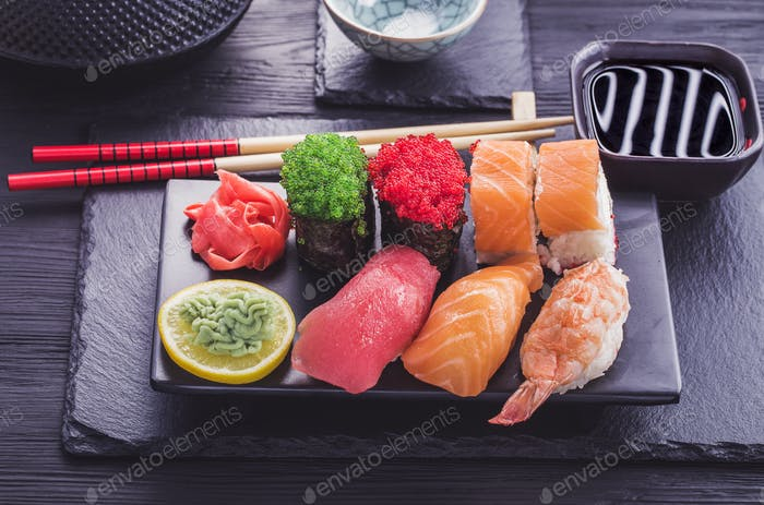 Japanese  sushi set on black tableware