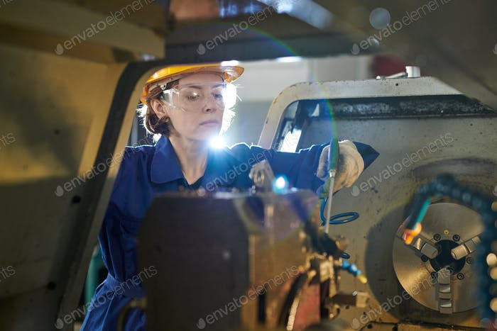 Woman Working at Factory Lens Flare