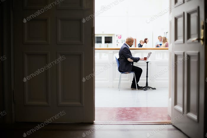 Teacher sitting at desk