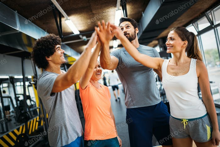 Portrait of cheerful fitness team in gym