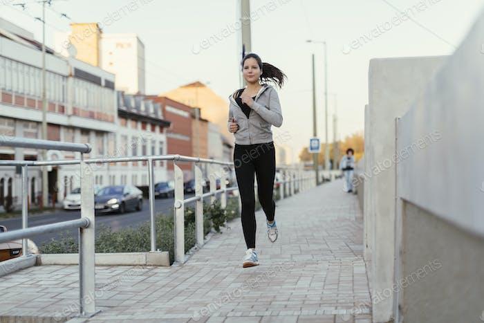 Beautiful female jogging in city