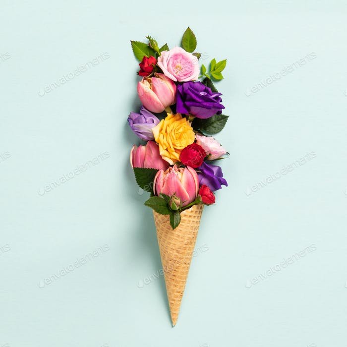 Ice cream cone with flowers and leaves. Summer minimal concept.