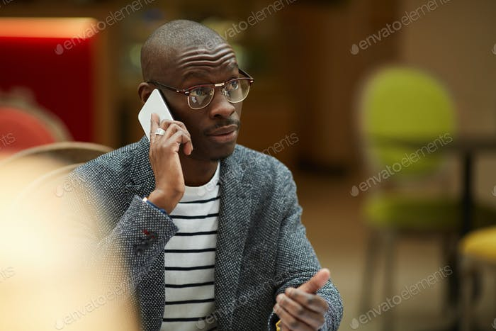 Contemporary African ManTalking by Phone