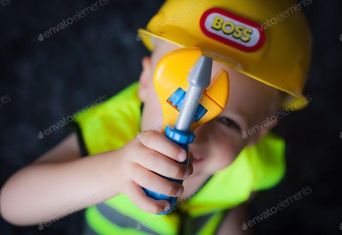 Little boy dressed as foreman builder