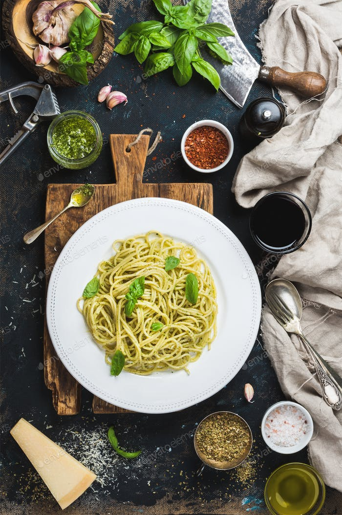 Spaghetti with pesto sauce, parmesan cheese, basil and wine