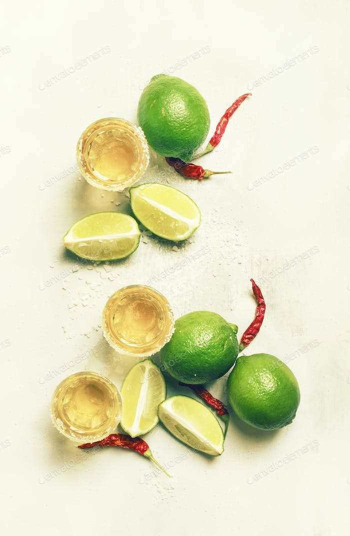 Golden mexican tequila with lime and salt
