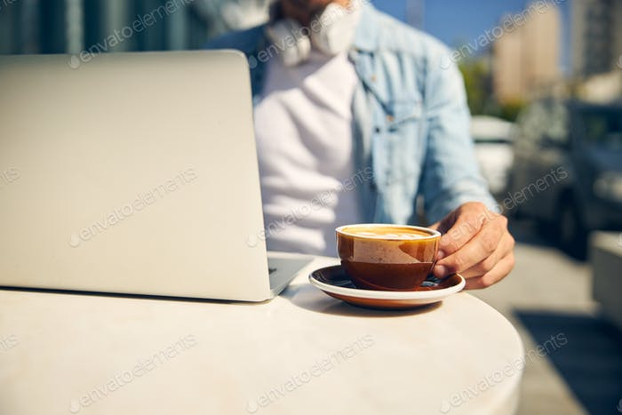 Busy freelancer going to drink coffee in cafe