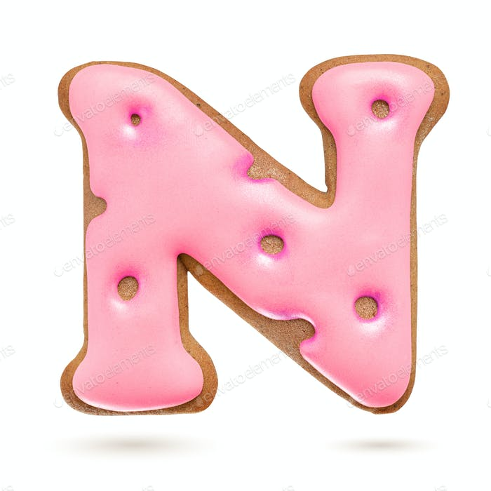 Capital letter N. Pink gingerbread biscuit isolated on white.