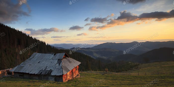 Panorama of the old house in the mountains at dawn