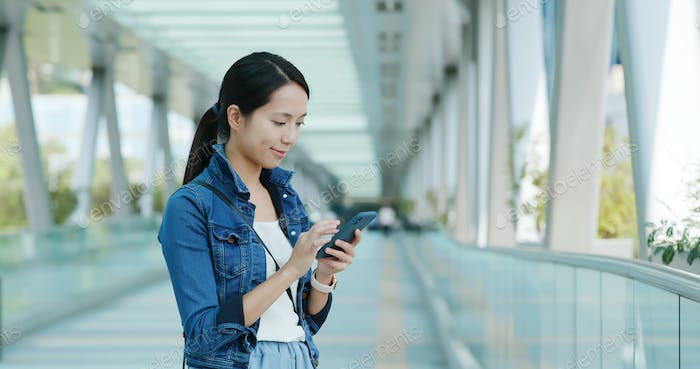 Woman use mobile phone online