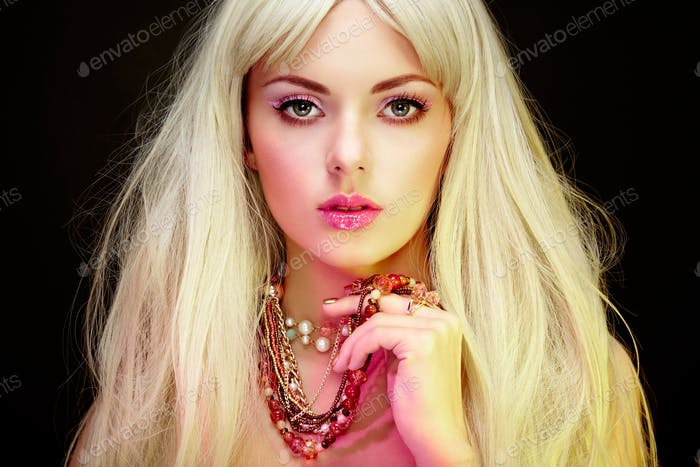 Fashion portrait of elegant blonde woman with magnificent hair