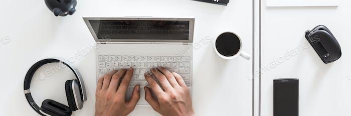 Notebook computer, headphones and coffee