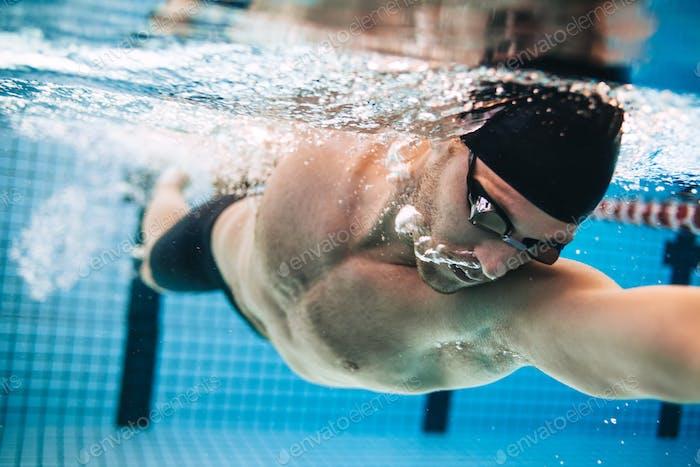 Male swimmer Under Water in Pool