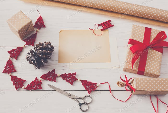 Creative hobby. Handmade tools for wrapping christmas present in box