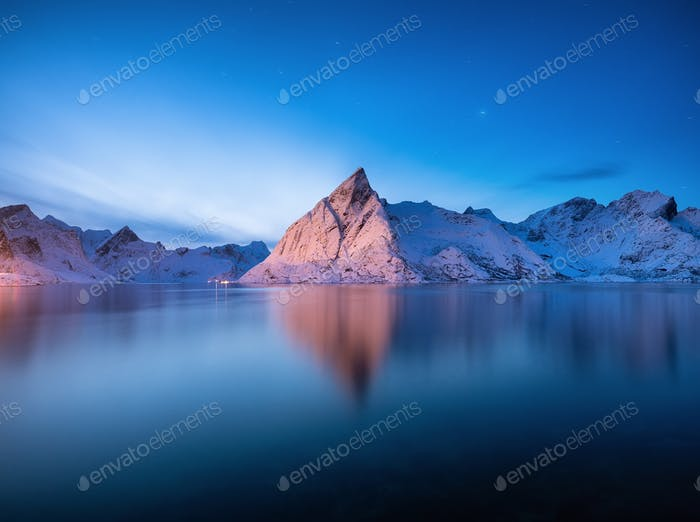 Mountains and reflection on water surface, Lofoten island, Norway. Landscape at the night time