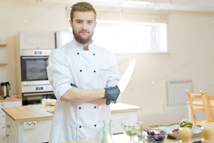 Handsome Professional Chef Posing in Kitchen