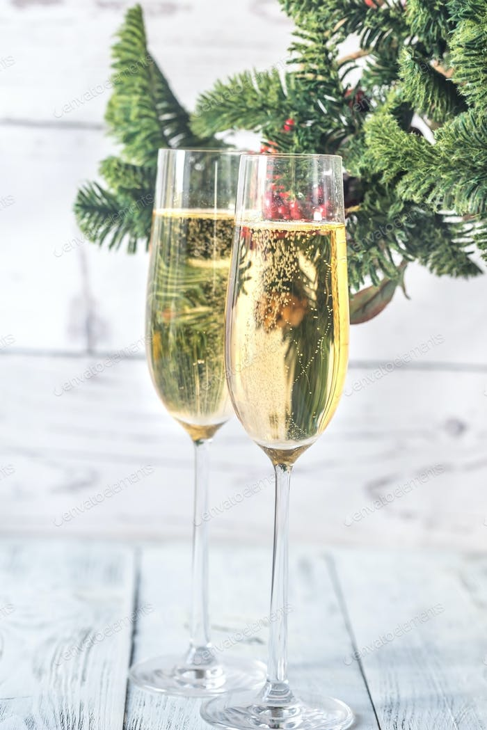 Glasses of champagne with Christmas tree