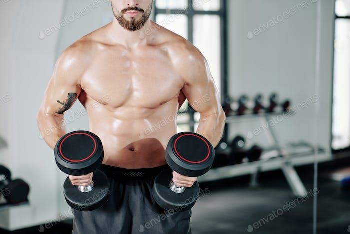 Exercising muscular man