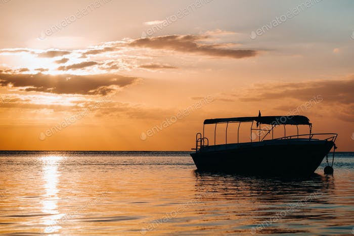 Boat at sunset in the Indian ocean off the coast of Mauritius
