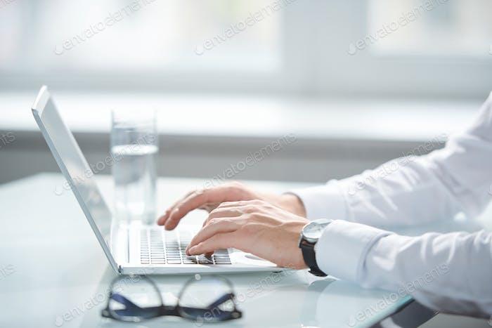 Typing on laptop keypad