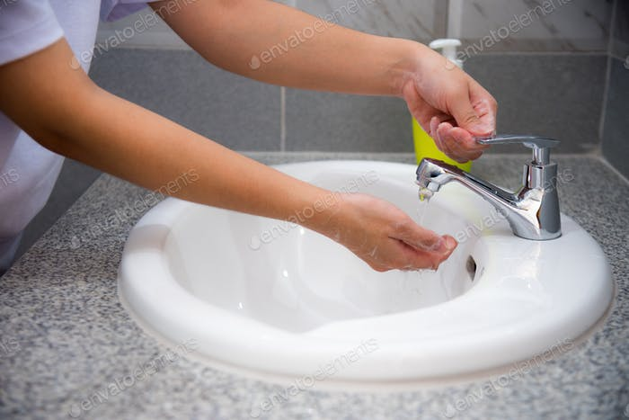 Woman wash hand with soap