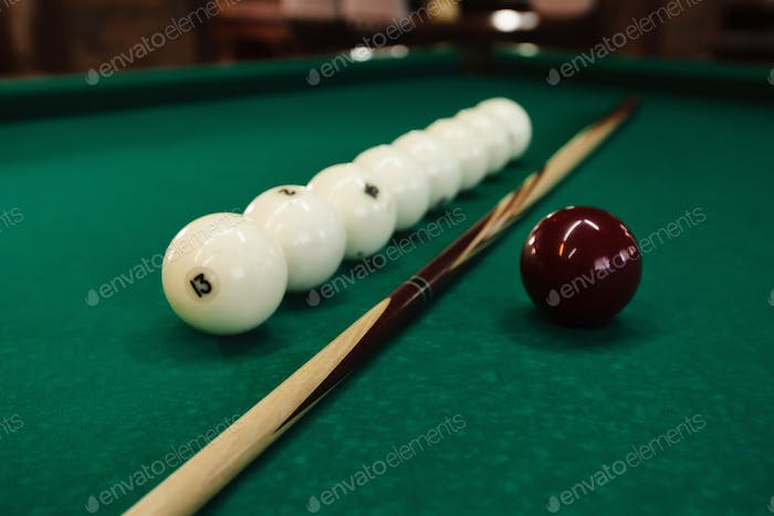 Billiard balls and pool sticks