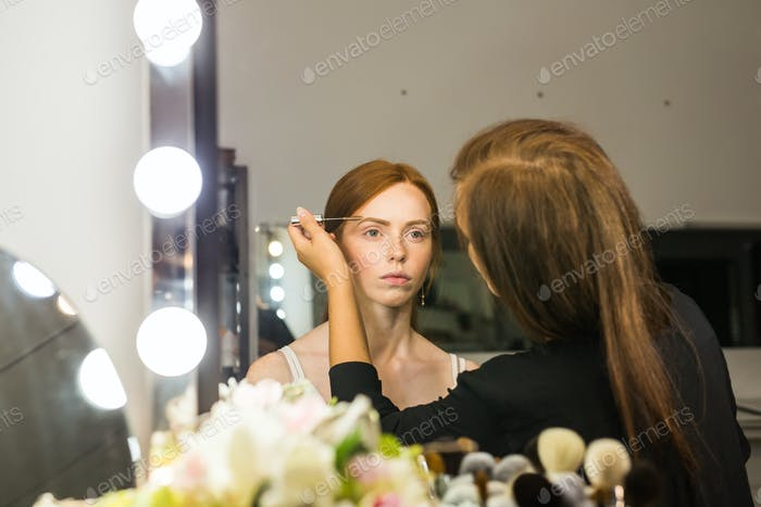 Process of making makeup. Make-up artist working