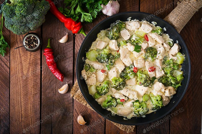 Thumbnail for Delicate saute chicken with broccoli and chili peppers in a creamy garlic sauce. Top view