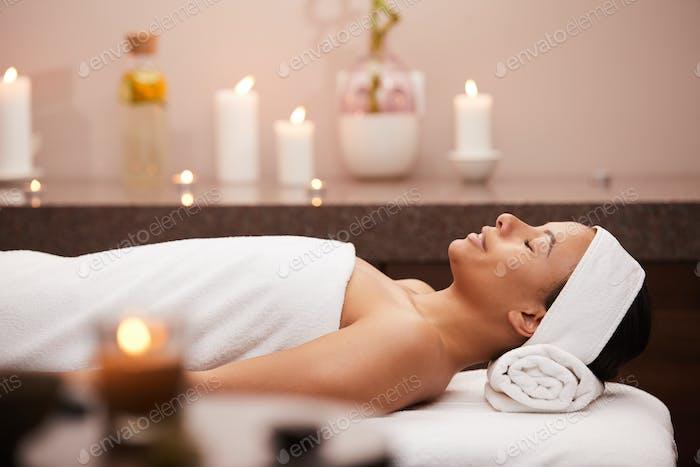 Beautiful Woman Lying on Massage Table