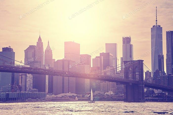 Vintage toned sunset over Manhattan and Brooklyn Bridge, NYC.
