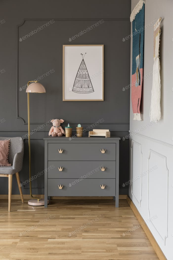 Real photo of a grey cupboard with ornaments standing next to a