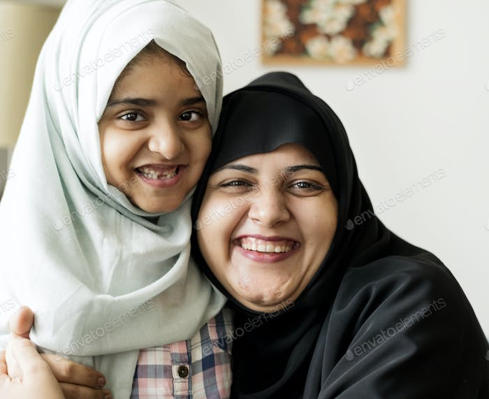 Smiling portrait of a Muslim mother and a daughter