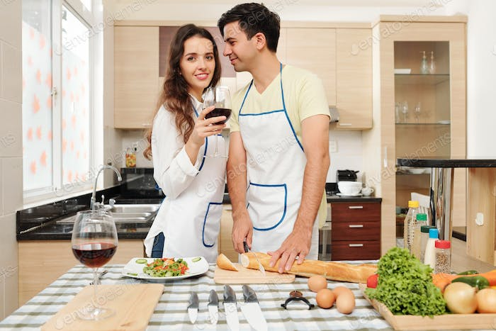 Man cooking dinner for wife