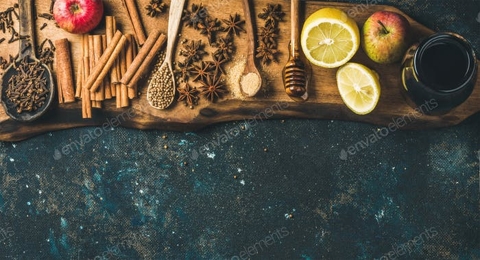 Ingredients for making mulled wine over blue painted plywood background