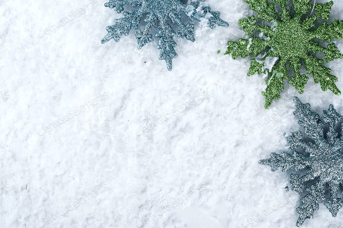 colored snowflakes on snow