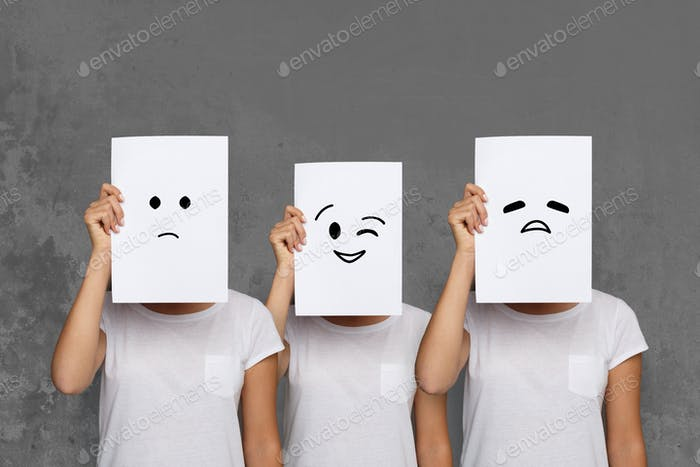 Girl covering face with white boards. Set of painted emotions