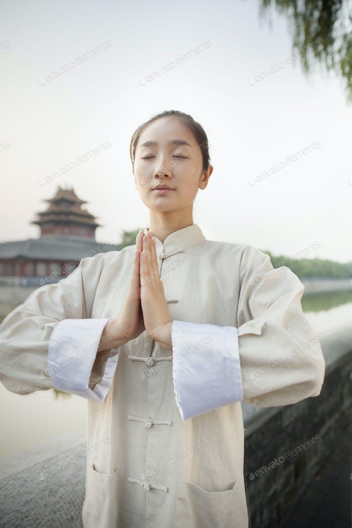 Young Woman Practicing Tai Ji