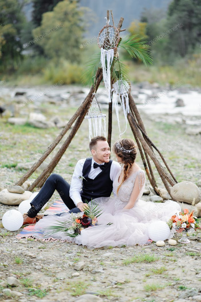 photosession of a couple in love. Wedding ceremony in the style of bokho