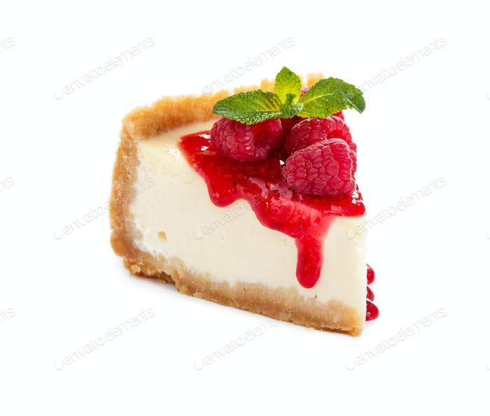 Piece of cheesecake with raspberries and mint