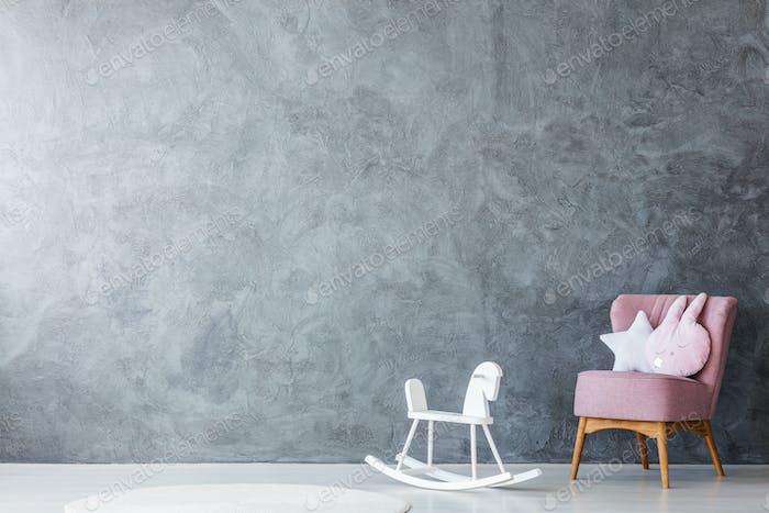 Pink armchair in kid's room