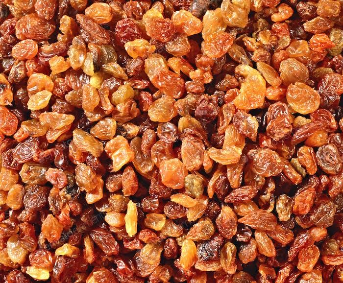 Golden raisins background or texture