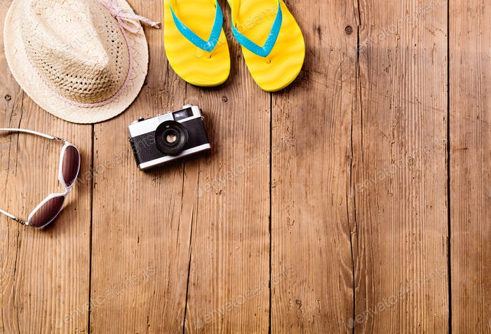 Summer vacation composition. Sunglasses, camera, hat, flip flops