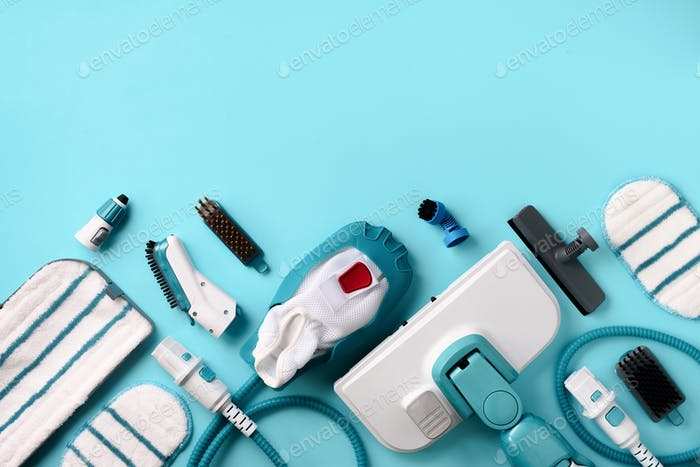 Kit of modern professional steam cleaners on blue background. Top view, flat lay. Banner with copy