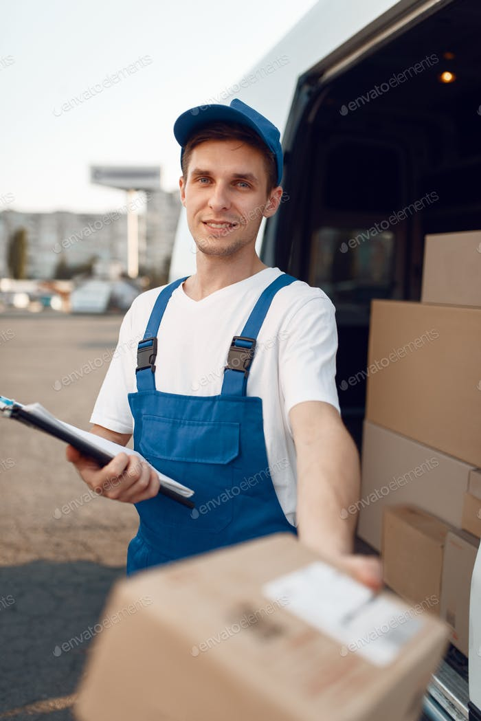 Deliveryman in uniform gives parcel, delivery