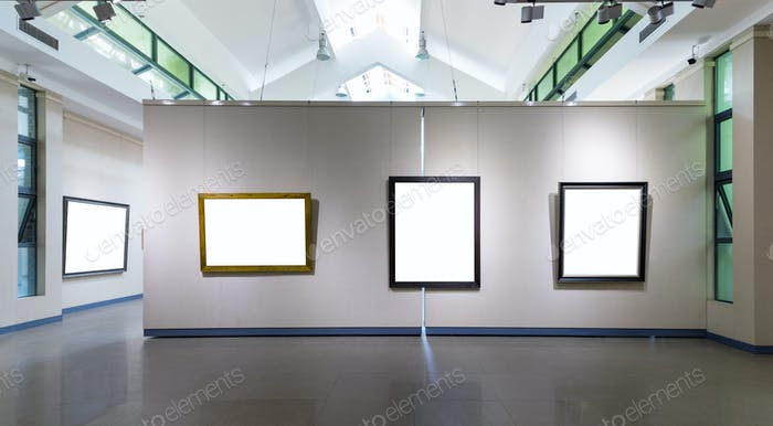 blank frames fro painting or photography on exhibition wall in a room