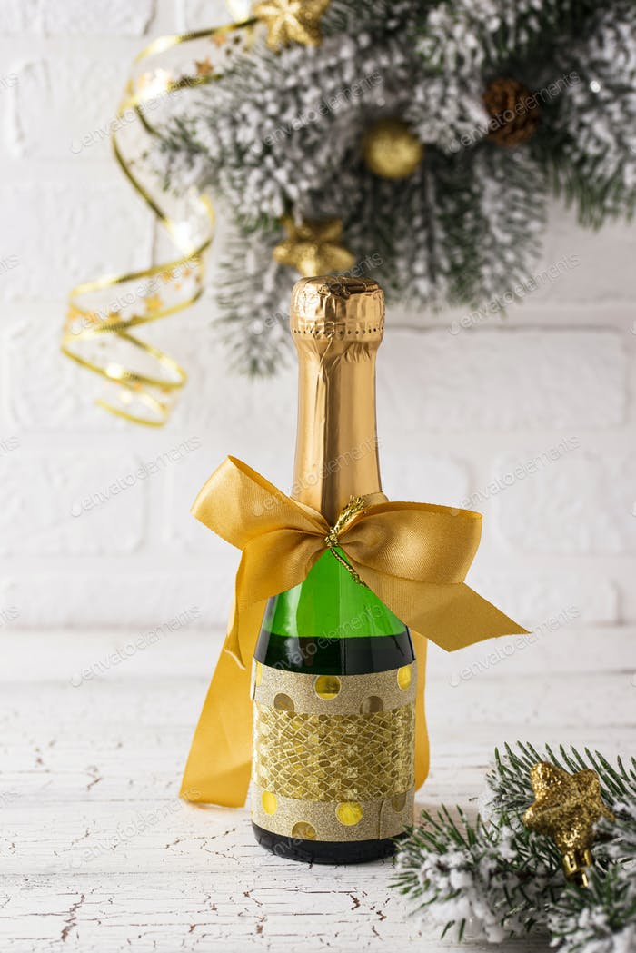 Bottle of champagne in a gold wrapper