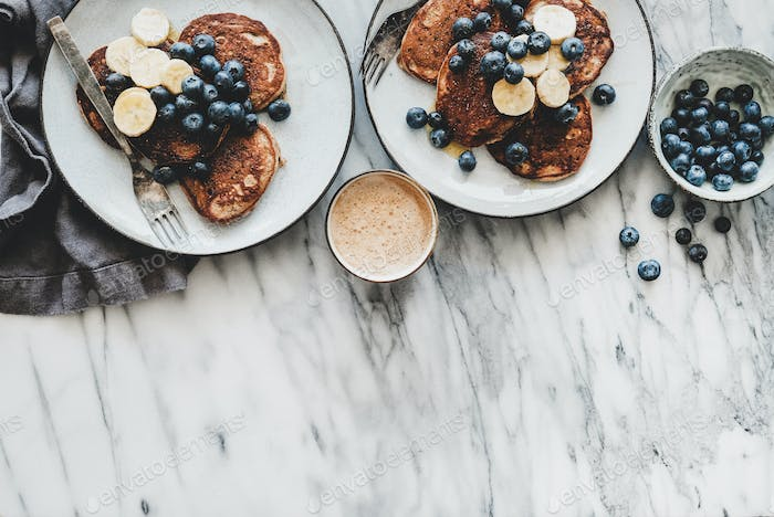 Breakfast banana pancakes with blueberry and coffee, copy space