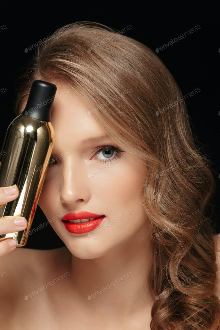 Close up beautiful girl with wavy hair and red lips covering eye