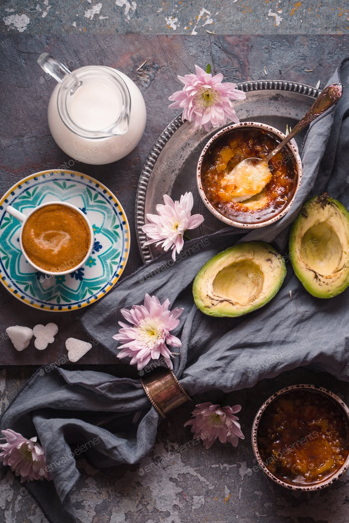 Still life with Catalan cream , avocado and cup of coffee on the stone background vertical